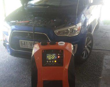 wynns multiserve diesel cleaning service hooked to heavy diesel vehicle